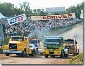 Racing lorry cabs around a Camion Cross circuit