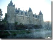 Josselin's Chateau at dawn, mist rising off the canal